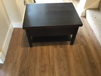 IKEA Coffee Table- Darkwood finish with good storage within table. Extendable.