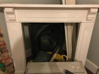 Cast Iron Victorian Fireplace and Wooden Surrounding Mantelpiece