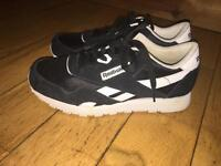 Black and white reebok classic trainers