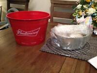 Budweiser bucket grill BBQ with accessories and charcoal.
