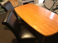 Dinner table 2 leather chairs