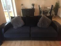 DFS Grey/black sofa and swivel chair with footstool