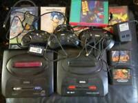Megadrive 2 X 2 consoles, games and cables