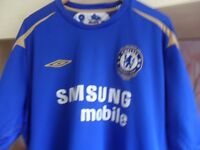 Two Chelsea FC football shirts.