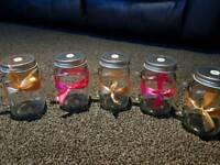 Glass drinking jars.