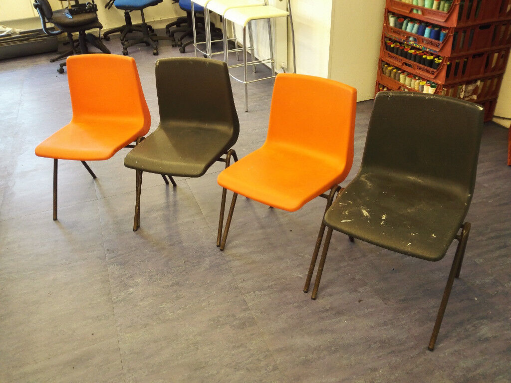 4 Vintage Industrial Orange and Black Plastic Stacking Cafe Bar Kitchen Chairs