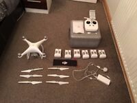 DJI Phantom 4 and 3 For sale with loads of extra batteries and cases