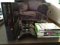 Xbox 360 w/ 2controllers & 5 games