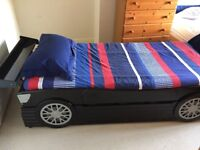 Racing car style single bed with pull out bed underneath