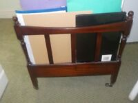 Mahogany magazine rack in very good condition.