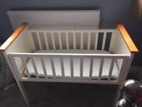 White shaker style crib.