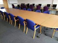 Large office boardroom table with sixteen chairs