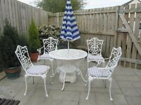Garden Furniture. Cast Table and 4 Chairs with Mauve Gingham Seat Pads and Parasol with Base.