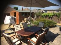 Garden table and chairs with cushions, parasol and base