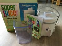 Super Juicer, Never Used. complete with recipe book , Instruction manual and box.