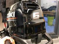 Suzuki 6hp 4 stroke outboard.