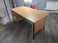 Classic pedestal desk with 2 side drawers in beech effect.