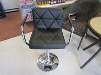 set of 2 black leather bar stools