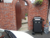 New 2 burner Gas BBQ with new bottle gas (unwanted present) (used once)