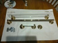 Gold effect bathroom fittings, shelf, towel rail, hook, toilet roll holder.