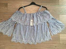Brand new with tags. M&S top size 14