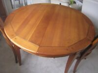 Dining Table in Cherrywood with 4 matching chairs plus 1 carver