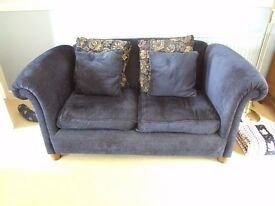 BLUE 2 SEATER SOFA AND MATCHING ARMCHAIR.SUPPLIED WITH CUSHION COVERS AND ARM REST PROTECTION