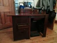 Beautiful Singer sewing machine in wooden cabinet