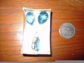 stunning earrings and matching pendant in topaz blue.
