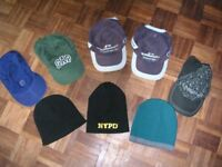 Selection of baseball caps and woolen hats