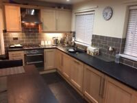 Beautiful light oak shaker style kitchen, with double oven/grill gas hob and extractor fan