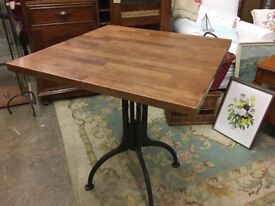 Lovely vintage table with heavy steel legs. Industrial look