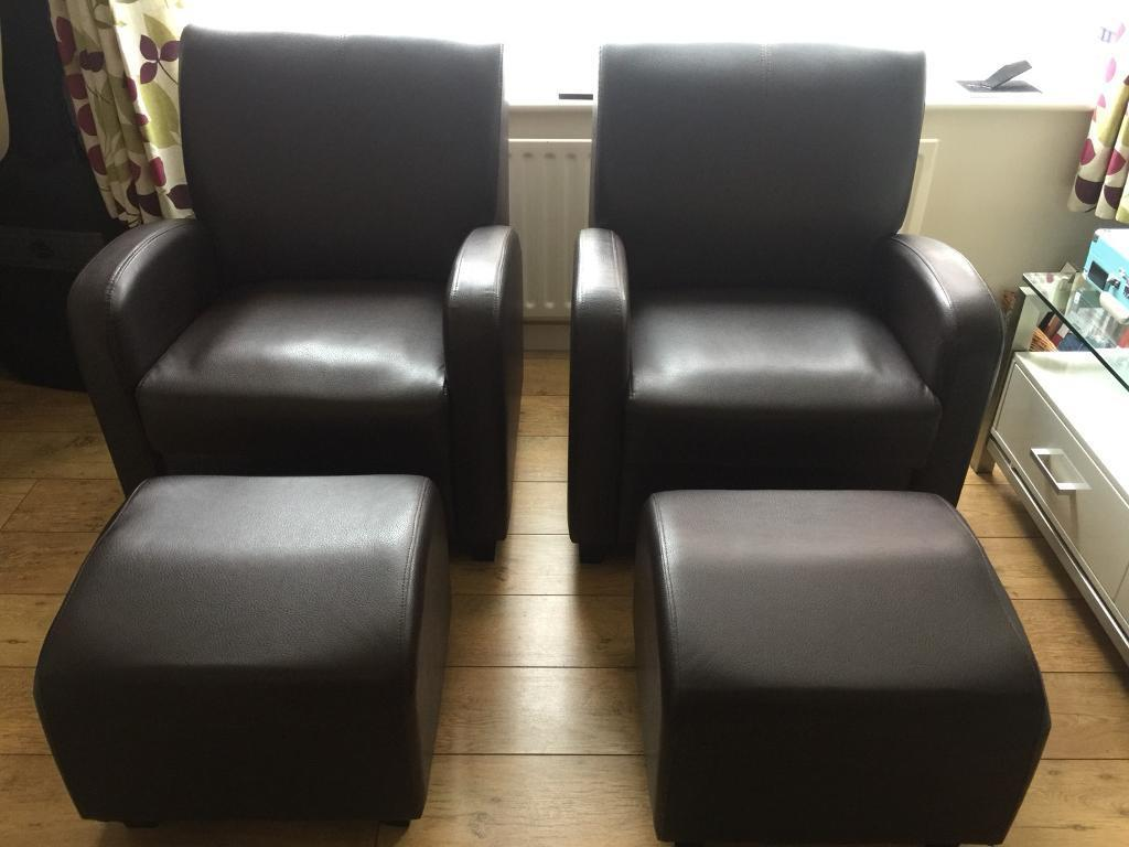 Pair of leather armchairs with footstools