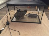 Aquarium with large submarine ornament and filter perfect working order