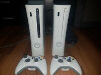 2 White xbox 360's