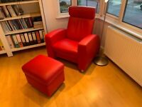 Modern, super-stylish and comfy red leather adjustable armchair with foot stool.