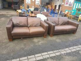 Modern brown leather twin two seater sofas