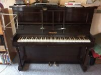 Old upright piano.