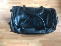 Brand new IT black leather large size luggage trolley wheeled holdall