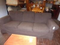A dark brown 3 seat sofa. 19/11