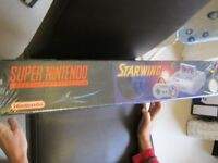 SNES CONSOLE PACKAGED WITH STARWING GAME– STILL IN ORIGINAL CELLOPHANE WRAPPER
