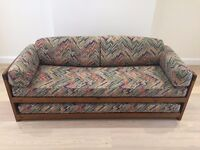 Sofa bed - wooden with trundle bed - includes mattresses and cushions.