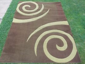 large green and brown rug