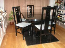 Black extending dinning table and 6 chairs