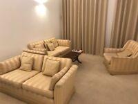 2 Sofas, an Armchair & a Coffee table