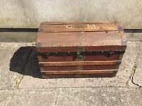 Antique dome shaped trunk full of character in its worn condition