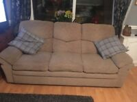Three seater brown sofa good condition
