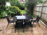 Hardly used Garden table and Chairs (6) set with Umbrella