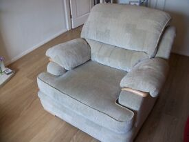 Lovely DFS Armchair and storage pouffe