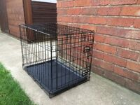 DOG CAGE / CRATE , 24 INCHES LONG, 17 INCHES WIDE AND 19 INCHES TALL